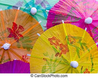 A closeup shot of some colourful cocktail umbrellas