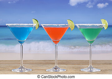 Colorful Cocktails in Martini glasses on the beach