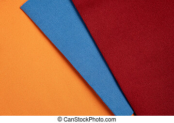 Colorful collection of textile samples. Fabric texture background.
