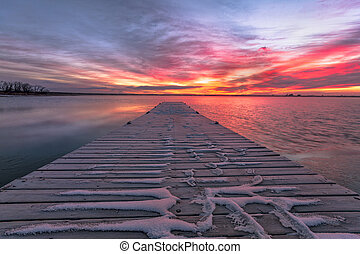 Colorful Colorado Sunrise over a fishing dock
