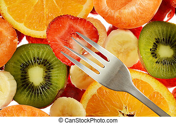 Colorful composition with variety of fruits and fork