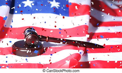 Colorful confetti falling over gavel against US flag