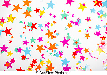 Colorful confetti in shape of stars on white background