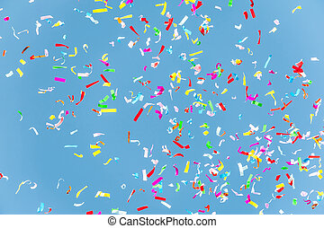 Colorful confetti in the blue sky