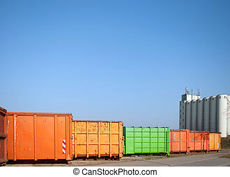 Colorful container for waste transport on an industrial site