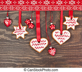 Colorful cookies for christmas on rustic wooden background