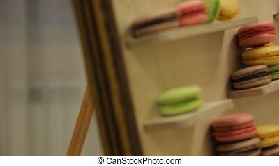 Colorful cookies laid out on sloped tray. - Colorful cookies...