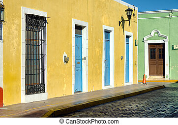 Colorful corner between two colonial houses in the street in Campeche, Mexico