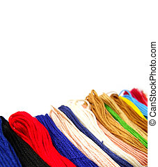 colorful cotton thread on white background