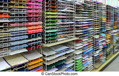 Colorful craft or scrapbook paper on shelves.