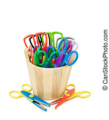 Colorful crafts scissors in wooden bucket. Isolated over...