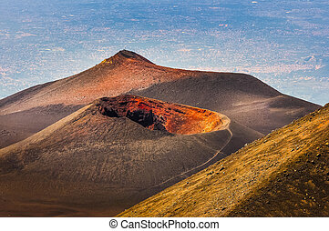 Colorful crater of Etna volcano with Catania in background,...