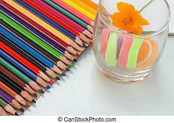 Colorful crayons and candy