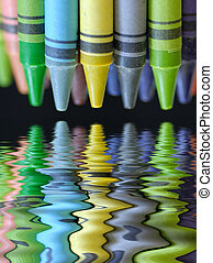 colorful crayons with beautiful reflection on black background