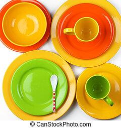 Colorful crockery - Set of empty colorful ceramic dishware...