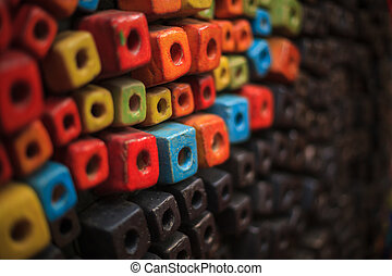 colorful cubes decorating wall background design, wallpaper, backdrop, abstract dice, box or bead shape.