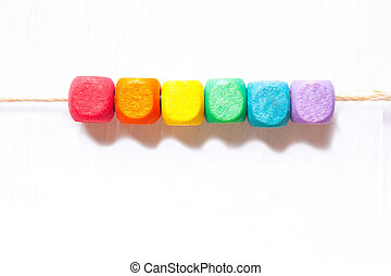Colorful cubes on a white background, the symbol of LGBT.