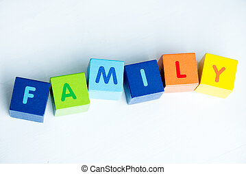 Colorful cubes with letters consists the word family on white