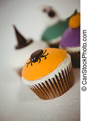 Colorful cup cakes over white background - Close up of ...