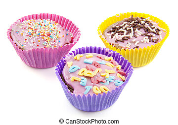 Colorful cup cakes - Three colorful decorated cupcakes ...