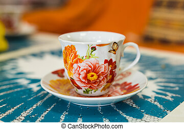 Colorful cup on a colored background - Colorful cup of tea ...