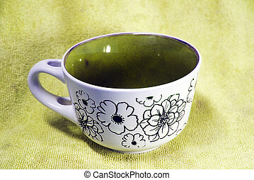 Colorful cup with background with colored fabric