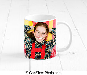 colorful cup with child printed on it