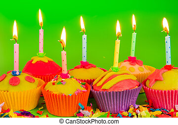 Colorful cupcakes with candles