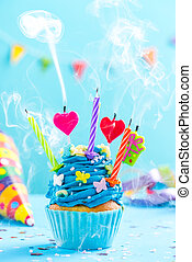 Colorful decorated cupcake with candles blow up. Birthday card mockup.