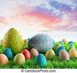Colorful decorated eggs in the grass