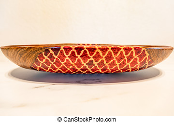 Colorful decorated hand made african wooden bowl