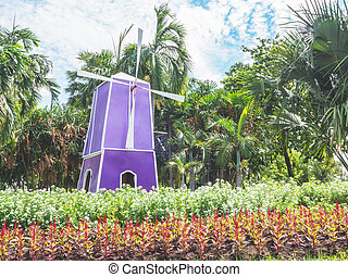 Colorful decorative windmill in the public park