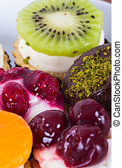 Colorful delicious cakes with fruits.