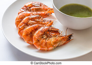 Colorful delicious grilled shrimp with spicy seafood sauce, Closeup - Frozen shrimp, fresh shrimp, sausage or bacon strips use indoor electric grill if the weather is not good for outside grilling.