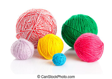 colorful different thread balls. wool knitting on white background