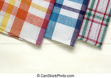 colorful dish towels on white wooden table
