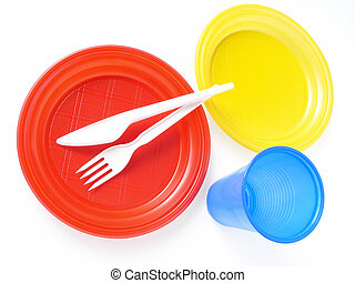 colorful disposable tableware set on white