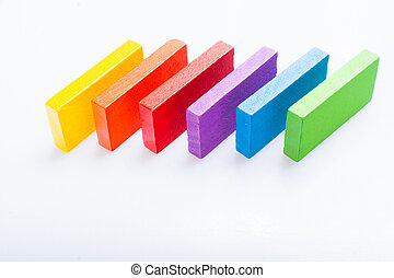 Colorful domino blocks on white background