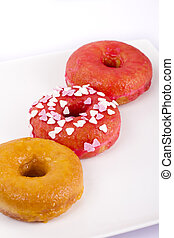 Colorful donut on a plate