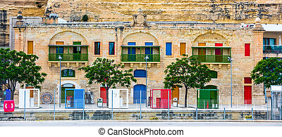colorful doors and windows in Valletta embankment