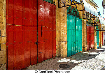 Colorful metal doors at famous market in old city of Jerusalem, Israel.
