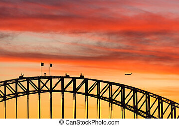 Colorful dramatic sky with silhouette of Sydney Harbour Bridge
