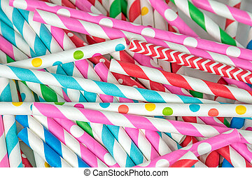 colorful drinking straw pile - close up of a pile of...