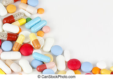Colorful drugs on white background