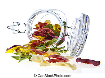 Colorful dry pasta in a jar on white background