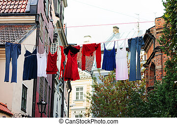 Colorful drying clothes on the street