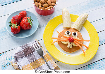 Colorful Easter breakfast for kids. Easter Bunny food art