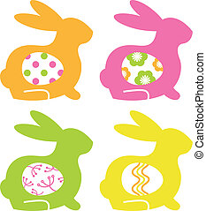 Colorful easter bunnies with eggs isolated on white