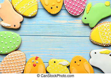 Colorful easter cookies on blue wooden background