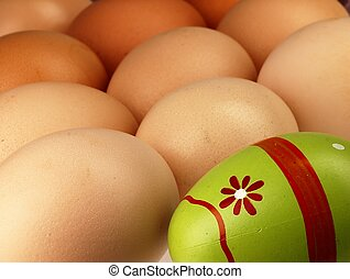 Colorful Easter egg in the company of ordinary eggs